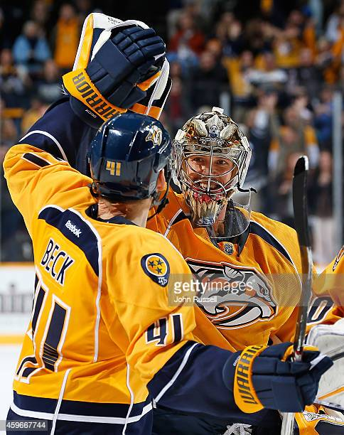 Pekka Rinne and Taylor Beck of the Nashville Predators celebrate an overtime shutout win against the Edmonton Oilers at Bridgestone Arena on November...