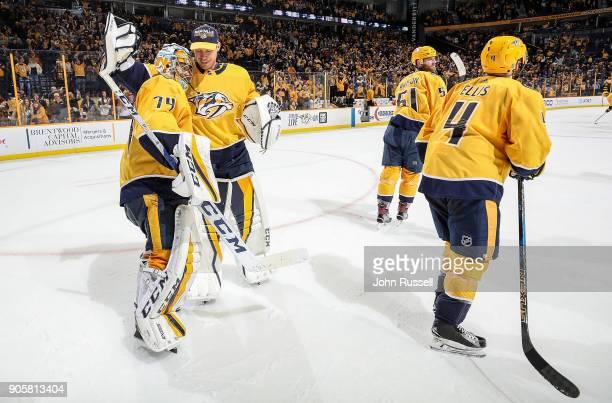 Pekka Rinne congratulates Juuse Saros of the Nashville Predators on his 10 shutout against the Vegas Golden Knights during an NHL game at Bridgestone...