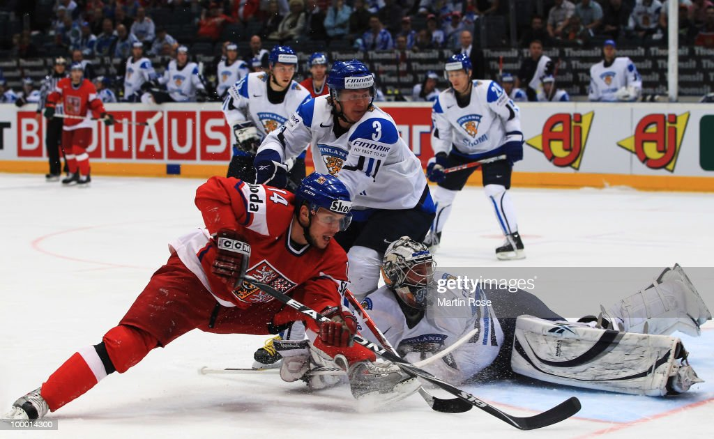 Pekka Rinne (R), goaltender of Finland saves the shot of Petr Vampola #14 of Czech Republic during the IIHF World Championship quarter final match between Finland and Czech Republic at Lanxess Arena on May 20, 2010 in Cologne, Germany.