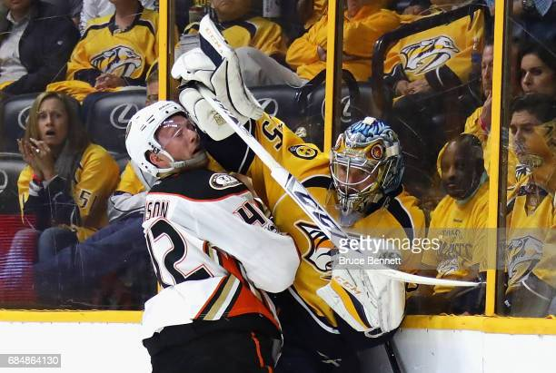 Pekka Rinne of the Nashville Predators battles along the boards with Josh Manson of the Anaheim Ducks during the second period in Game Four of the...