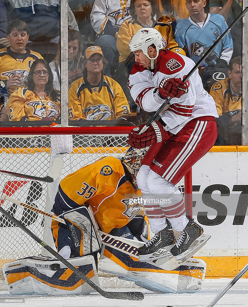 Pekka Rinne #35 of the Nashville Predators blocks a shot against David Moss #18 of the Phoenix Coyotes during an NHL game at Bridgestone Arena on April 10, 2014 in Nashville, Tennessee.