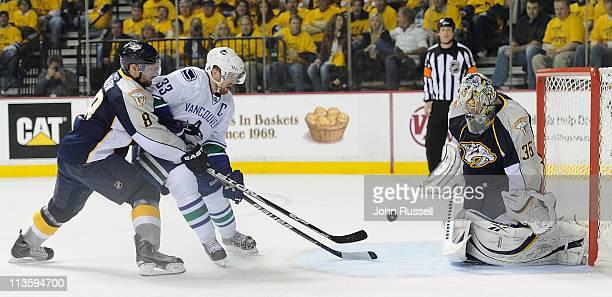 Pekka Rinne of the Nashville Predators blocks the shot of Henrik Sedin of the Vancouver Canucks as Predators Kevin Klein defends in Game Three of the...