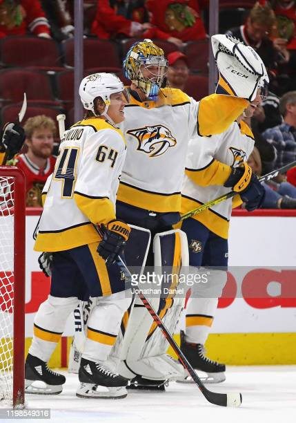 Pekka Rinne of the Nashville Predators celebrates his first career goal an empty net shot with teammates including Mikael Granlund against the...