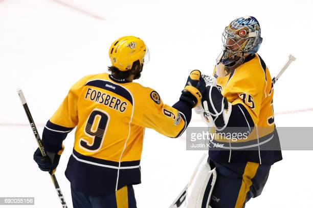 Pekka Rinne of the Nashville Predators celebrates with Filip Forsberg after defeating the Pittsburgh Penguins 51 in Game Three of the 2017 NHL...