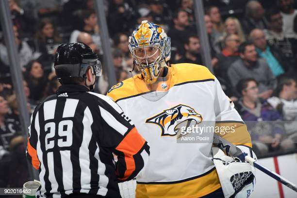 Pekka Rinne of the Nashville Predators converses with referee Ian Walsh during a game against the Los Angeles Kings at STAPLES Center on January 6...