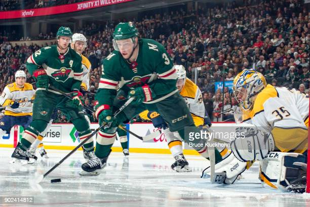 Pekka Rinne of the Nashville Predators defends against Charlie Coyle of the Minnesota Wild during the game at the Xcel Energy Center on December 29...