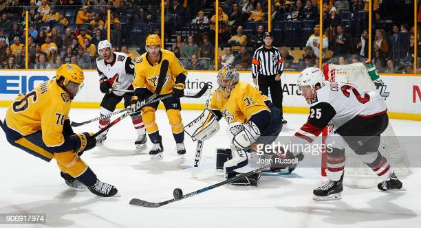 Pekka Rinne of the Nashville Predators deflects a shot against Nick Cousins of the Arizona Coyotes as PK Subban defends during an NHL game at...