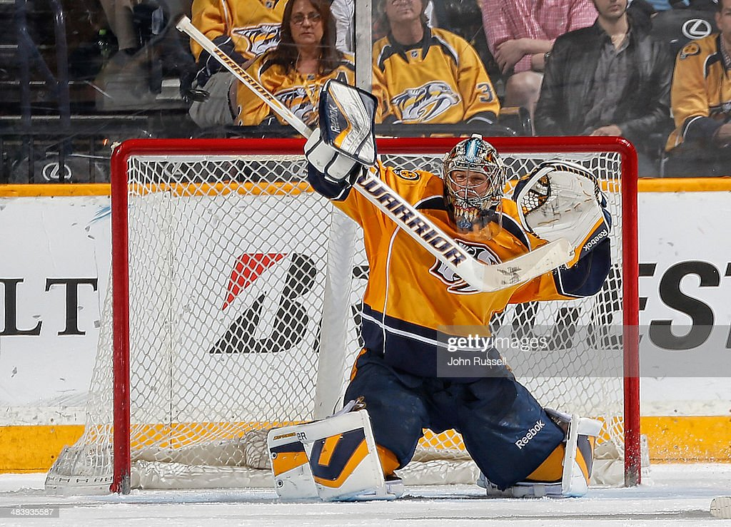 Pekka Rinne #35 of the Nashville Predators deflects a shot against the Phoenix Coyotes during an NHL game at Bridgestone Arena on April 10, 2014 in Nashville, Tennessee.