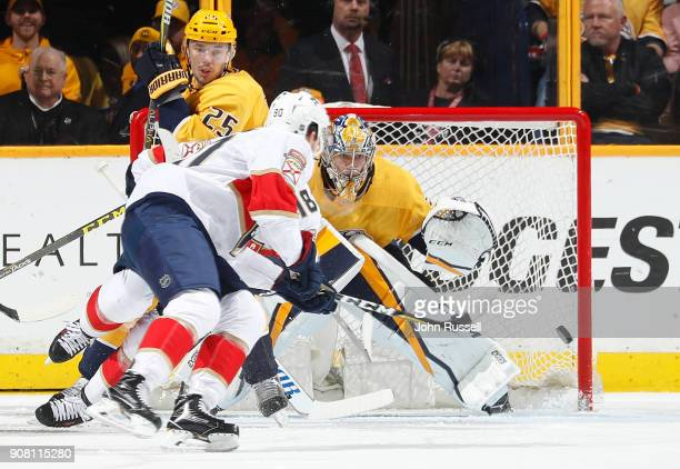 Pekka Rinne of the Nashville Predators eyes the puck against Jared McCann of the Florida Panthers during an NHL game at Bridgestone Arena on January...