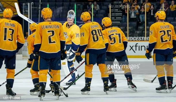 Pekka Rinne of the Nashville Predators is celebrated by his teammates and fans after a 5-0 win against the Carolina Hurricanes at Bridgestone Arena...