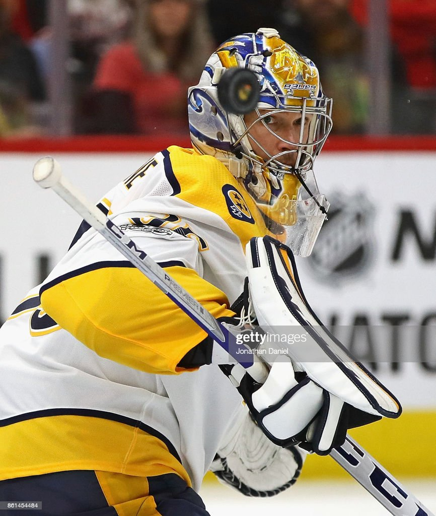 Pekka Rinne #35 of the Nashville Predators looks at the puck after making a save with his stick against the Chicago Blackhawks at the United Center on October 14, 2017 in Chicago, Illinois. The Blackhawks defeated the Predators 2-1 in overtime.