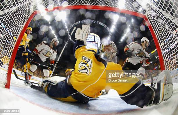 Pekka Rinne of the Nashville Predators looks back as he tends goal against Ryan Kesler and Andrew Cogliano of the Anaheim Ducks during the second...