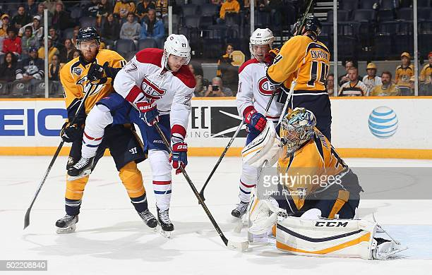 Pekka Rinne of the Nashville Predators makes a glove save against Alex Galchenyuk of the Montreal Canadiens during an NHL game at Bridgestone Arena...