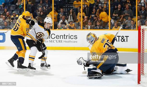 Pekka Rinne of the Nashville Predators makes a glove save against Anders Bjork of the Boston Bruins as PK Subban defends during an NHL game at...