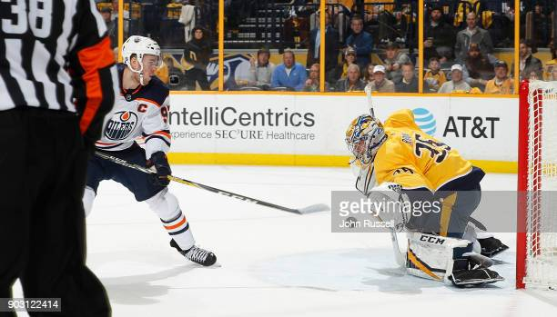 Pekka Rinne of the Nashville Predators makes a glove save against Connor McDavid of the Edmonton Oilers during an NHL game at Bridgestone Arena on...