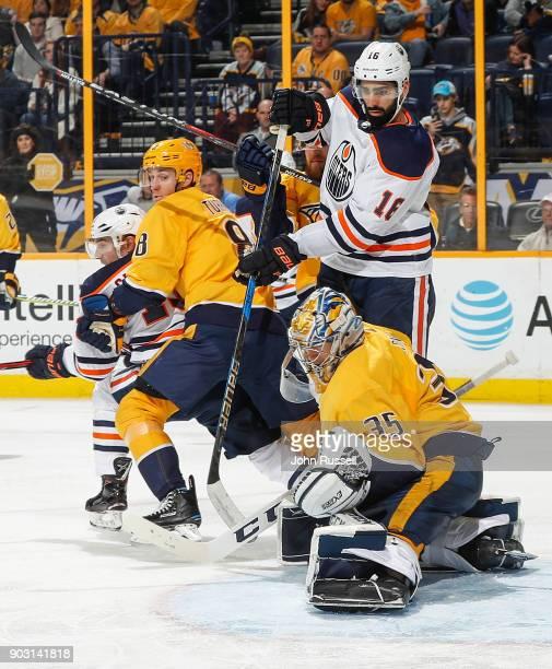 Pekka Rinne of the Nashville Predators makes a glove save against Jujhar Khaira of the Edmonton Oilers as Predators Kyle Turris battles in front of...