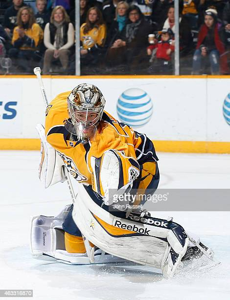 Pekka Rinne of the Nashville Predators makes a glove save against the Winnipeg Jets during an NHL game at Bridgestone Arena on February 12 2015 in...