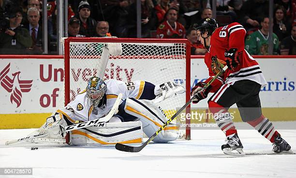 Pekka Rinne of the Nashville Predators makes a save against Andrew Shaw of the Chicago Blackhawks at the United Center on January 12 2016 in Chicago...