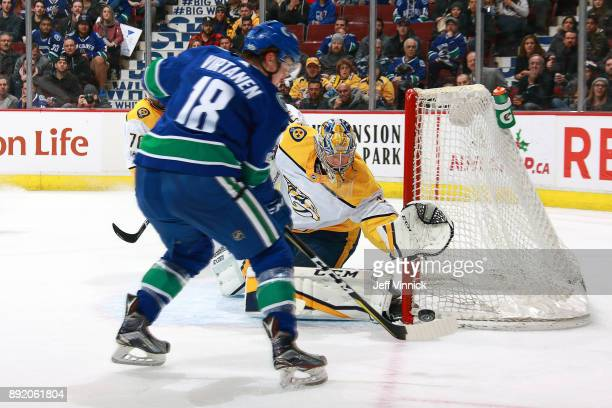Pekka Rinne of the Nashville Predators makes a save against Jake Virtanen of the Vancouver Canucks during their NHL game at Rogers Arena December 13...