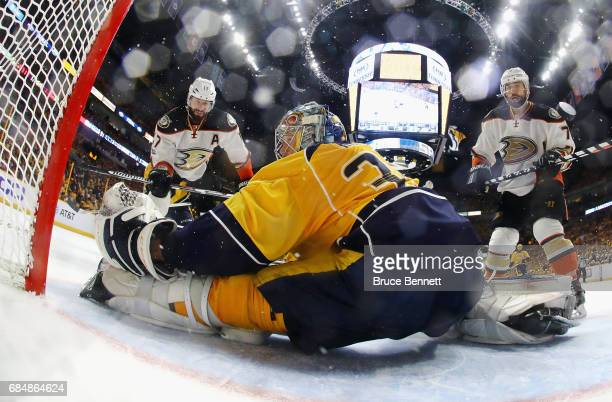 Pekka Rinne of the Nashville Predators makes a save against Ryan Kesler and Andrew Cogliano of the Anaheim Ducks during the second period in Game...