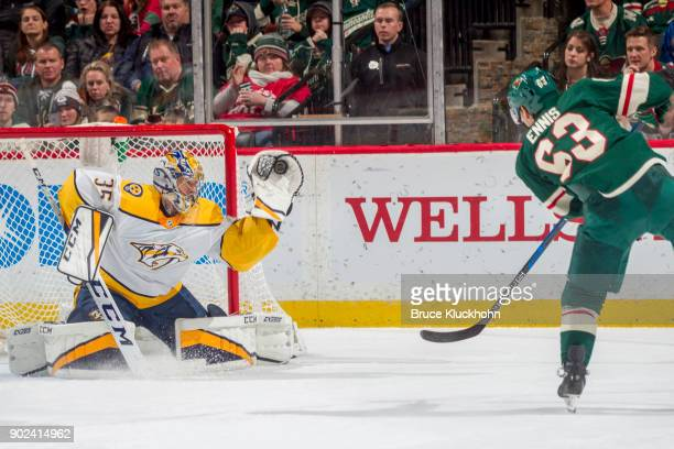 Pekka Rinne of the Nashville Predators makes a save against Tyler Ennis of the Minnesota Wild during the game at the Xcel Energy Center on December...