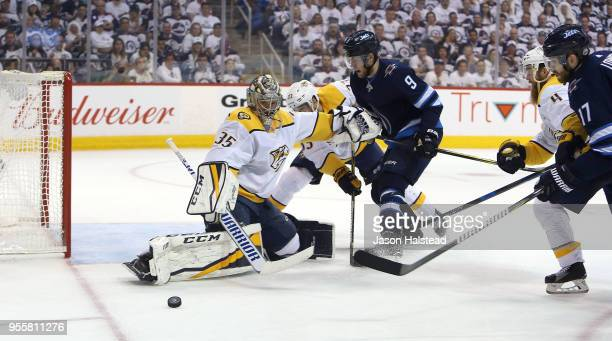 Pekka Rinne of the Nashville Predators makes a save as Andrew Copp of the Winnipeg Jets looks for a rebound in Game Six of the Western Conference...