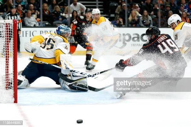 Pekka Rinne of the Nashville Predators makes a save as Max Jones of the Anaheim Ducks tries for a shot on goal during the third period at Honda...