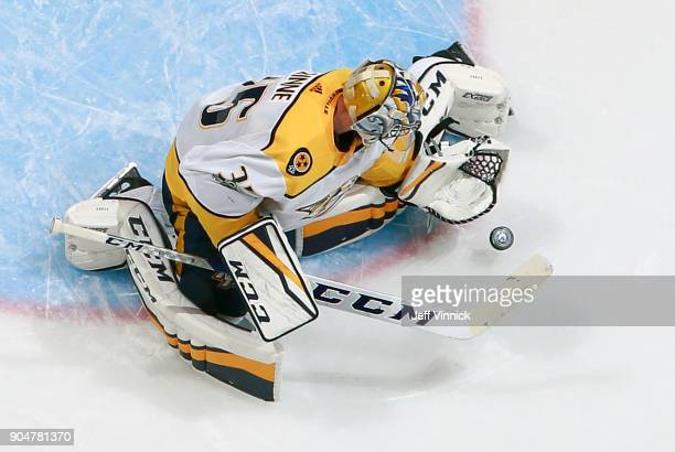 Pekka Rinne of the Nashville Predators makes a save during their NHL game against the Vancouver Canucks at Rogers Arena December 13 2017 in Vancouver...