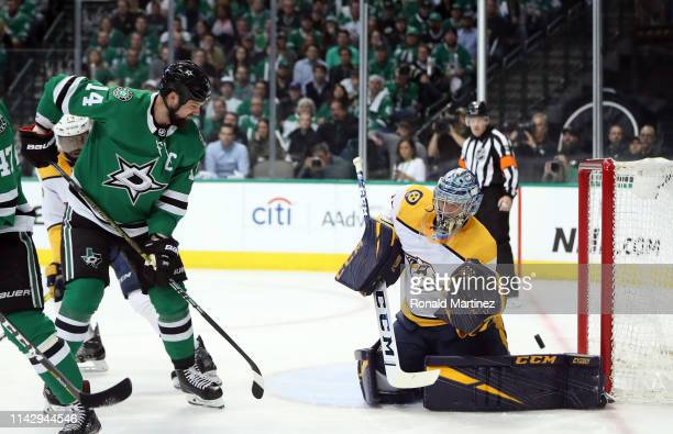 Pekka Rinne of the Nashville Predators makes a save in front of Jamie Benn of the Dallas Stars in the first period of Game Three of the Western...