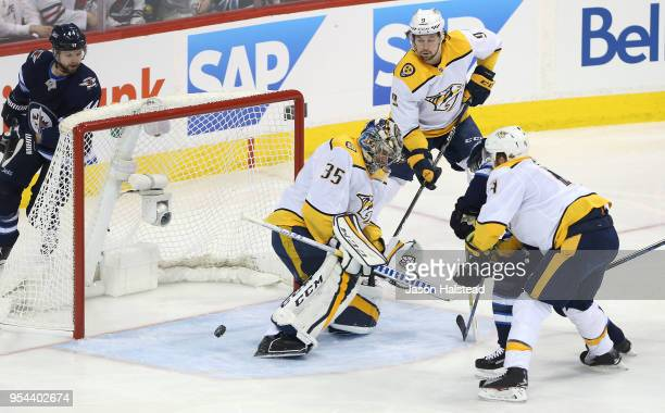 Pekka Rinne of the Nashville Predators makes a save off Bryan Little of the Winnipeg Jets in Game Four of the Western Conference Second Round during...