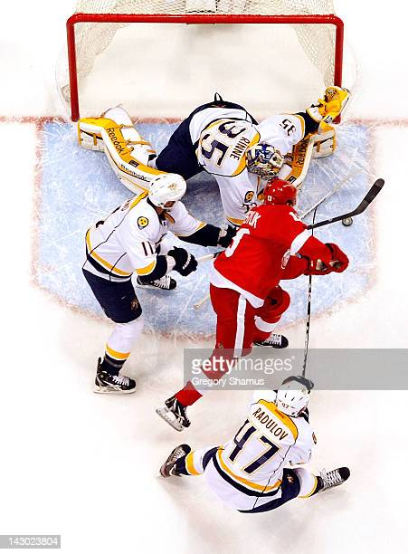 Pekka Rinne of the Nashville Predators makes a save on a shot by Pavel Datsyuk of the Detroit Red Wings with help from teammates Alexander Radulov...
