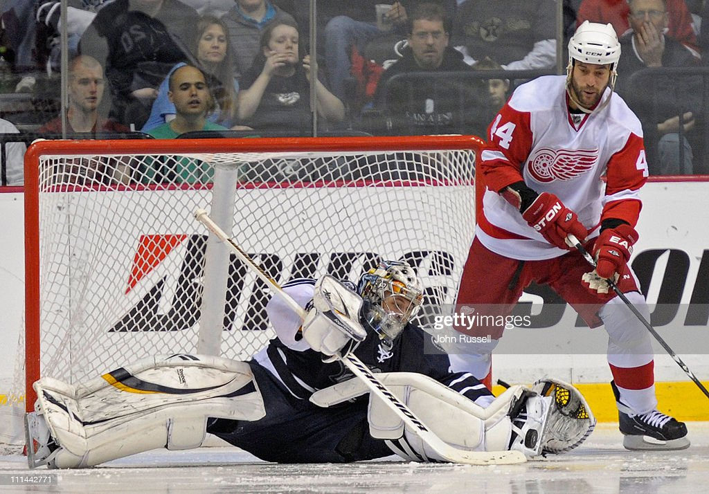 Pekka Rinne #35 of the Nashville Predators makes a sprawling save against Todd Bertuzzi #44 of the Detroit Red Wings during an NHL game on April 2, 2011 at Bridgestone Arena in Nashville, Tennessee.