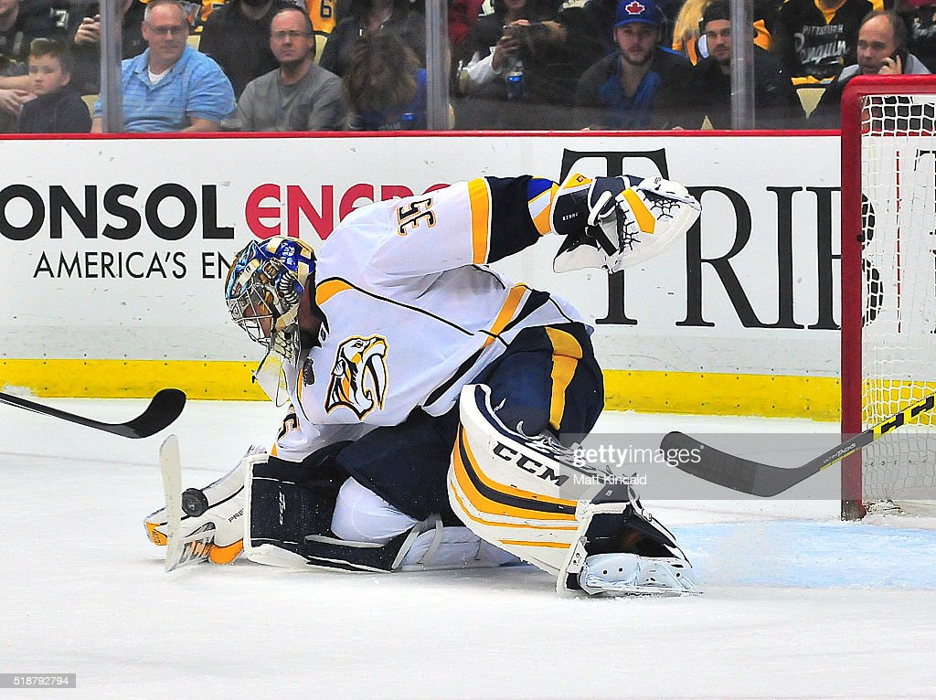 Pekka Rinne #35 of the Nashville Predators makes a stick save against the Pittsburgh Penguins at Consol Energy Center on March 31, 2016 in Pittsburgh, Pennsylvania.