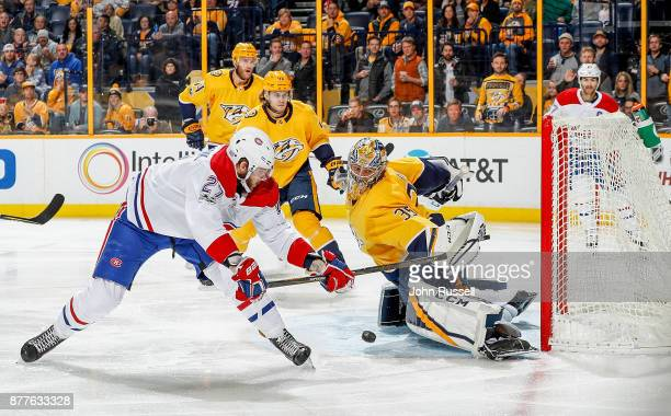 Pekka Rinne of the Nashville Predators makes the save against Alex Galchenyuk of the Montreal Canadiens during an NHL game at Bridgestone Arena on...