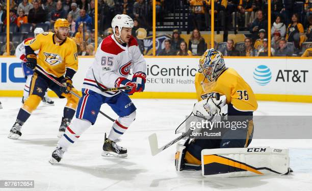 Pekka Rinne of the Nashville Predators makes the save against Andrew Shaw of the Montreal Canadiens during an NHL game at Bridgestone Arena on...