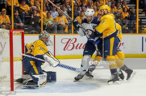 Pekka Rinne of the Nashville Predators makes the save against Blake Wheeler of the Winnipeg Jets as Nick Bonino defends in Game Two of the Western...