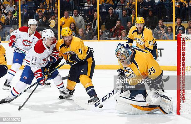 Pekka Rinne of the Nashville Predators makes the save against Brendan Gallagher of the Montreal Canadiens as Predators Ryan Ellis defends during an...