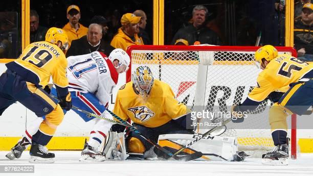 Pekka Rinne of the Nashville Predators makes the save against Brendan Gallagher of the Montreal Canadiens as Calle Jarnkrok and Roman Josi defend...