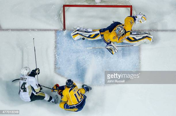 Pekka Rinne of the Nashville Predators makes the save against Chris Kunitz of the Pittsburgh Penguins at Bridgestone Arena on March 4 2014 in...