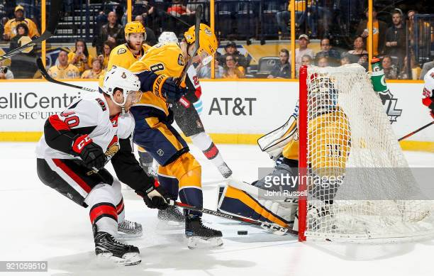 Pekka Rinne of the Nashville Predators makes the save against Gabriel Dumont of the Ottawa Senators as Kyle Turris defends during an NHL game at...