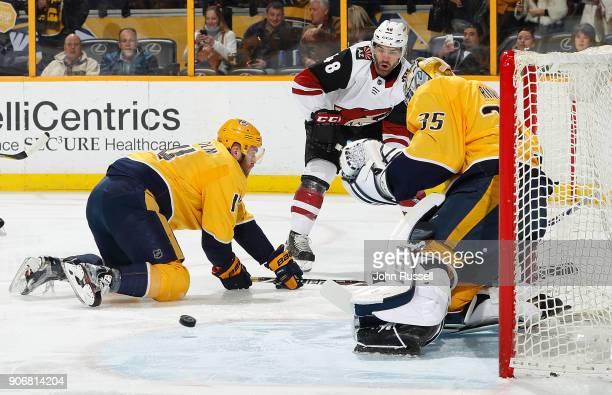 Pekka Rinne of the Nashville Predators makes the save against Jordan Martinook of the Arizona Coyotes as Mattias Ekholm defends during an NHL game at...