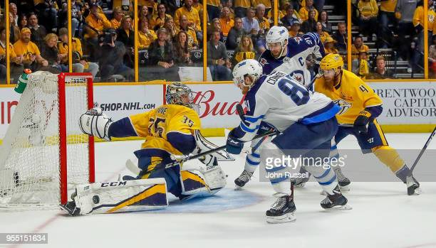 Pekka Rinne of the Nashville Predators makes the save against Kyle Connor of the Winnipeg Jets in Game Five of the Western Conference Second Round...