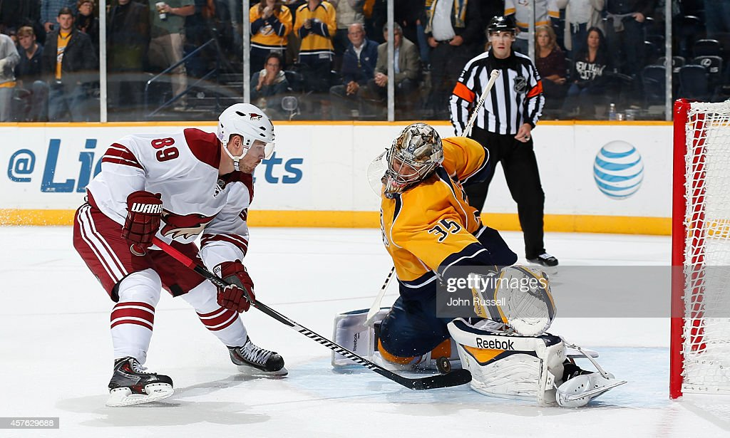 Pekka Rinne #35 of the Nashville Predators makes the save against Mikkel Boedker #89 of the Arizona Coyotes in a shootout at Bridgestone Arena on October 21, 2014 in Nashville, Tennessee.