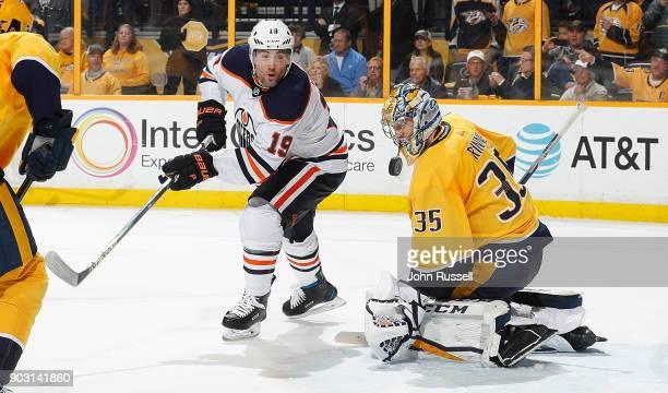 Pekka Rinne of the Nashville Predators makes the save against Patrick Maroon of the Edmonton Oilers during an NHL game at Bridgestone Arena on...