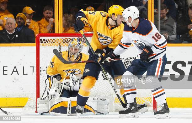 Pekka Rinne of the Nashville Predators makes the save against Ryan Strome of the Edmonton Oilers as Alexei Emelin defends during an NHL game at...