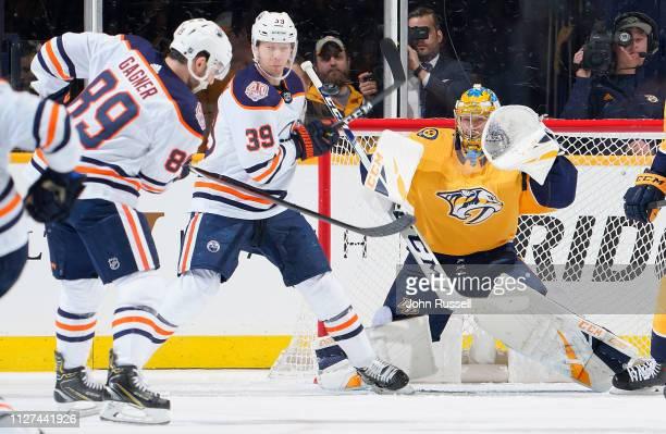 Pekka Rinne of the Nashville Predators makes the save against Sam Gagner and Alex Chiasson of the Edmonton Oilers at Bridgestone Arena on February 25...