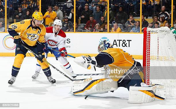 Pekka Rinne of the Nashville Predators makes the save against the Montreal Canadiens during an NHL game at Bridgestone Arena on January 3 2017 in...
