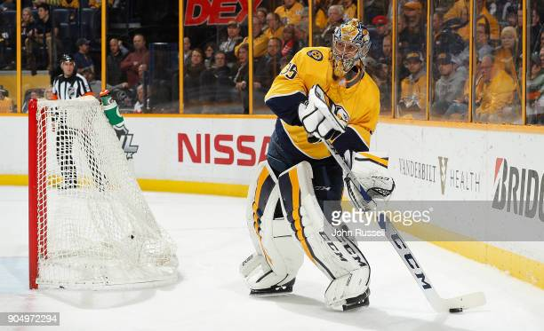 Pekka Rinne of the Nashville Predators plays the puck against the Edmonton Oilers during an NHL game at Bridgestone Arena on January 9 2018 in...