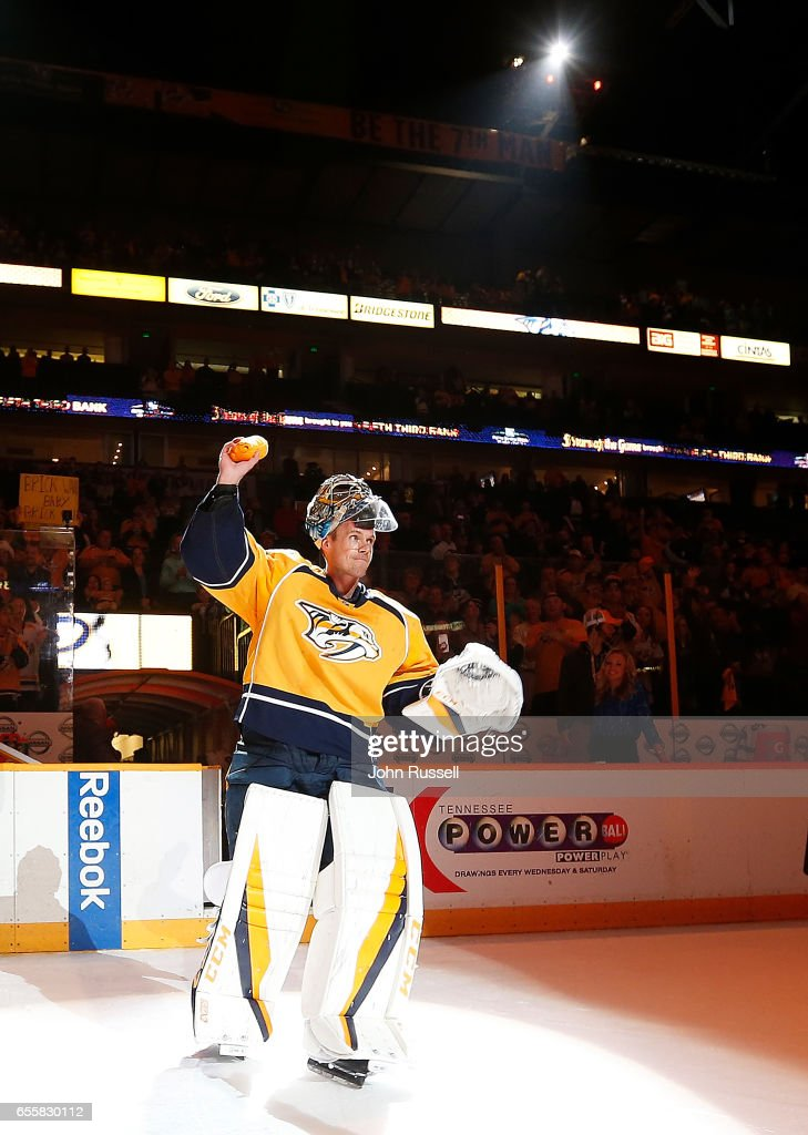 Pekka Rinne #35 of the Nashville Predators salutes the fans after a 3-1 win against the Arizona Coyotes during an NHL game at Bridgestone Arena on March 20, 2017 in Nashville, Tennessee.