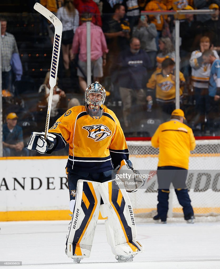 Pekka Rinne #35 of the Nashville Predators salutes the fans after his shutout win against the Phoenix Coyotes during an NHL game at Bridgestone Arena on April 10, 2014 in Nashville, Tennessee.